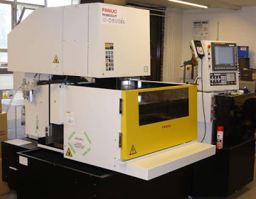 Photograph of one of our wire electro-discharge machines (wire EDM or wEDM).